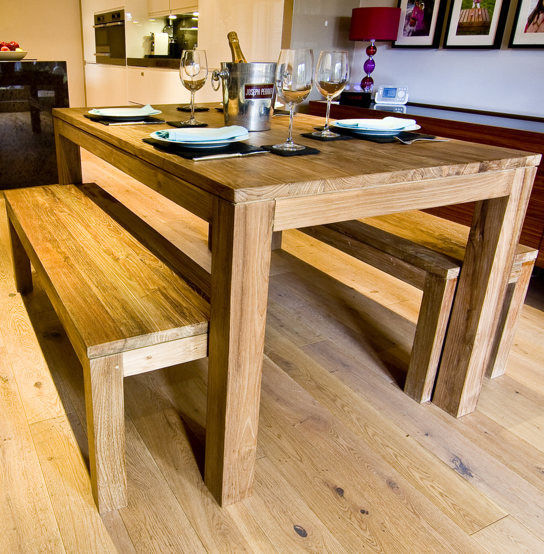 How to Make a Dining Farmhouse Table – Step-by-Step DIY Guide -- Wooden farmhouse table with rustic benches for a summer residence