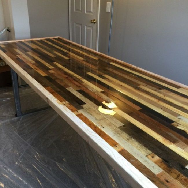 How to make a DIY Epoxy Resin Table - River Table – Step-by-Step Guide --The resulting Resin-Hardener-mix is applied to a wooden surface
